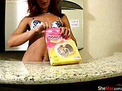 Redhead tranny in colorful bikini masturbates in the kitchen