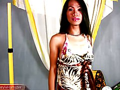 Pretty face ladyboy poses in bikini and strokes curved cock - clip # 02
