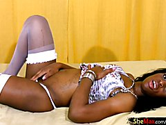 Pretty ebony tranny poses in white stockings and masturbates