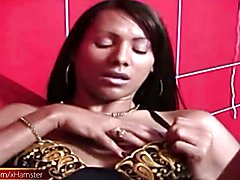 Black tranny with decent tits tugs her girl rod on red sofa  - clip # 02