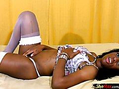 Pretty ebony tranny poses in white stockings and masturbates  - clip # 02