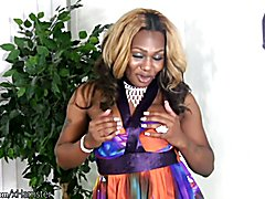 Black mature TS with blond curly hair strips down and wanks  - clip # 02
