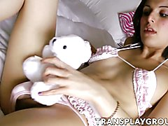 Attractive shemale Alisha plays with a huge red sex toy