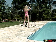 Feminine tgirl strips by the pool and oiles up her sexy body