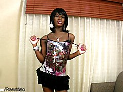 Pretty face ebony shemale deepthroats a massive white boner