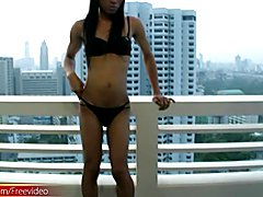 Slim ladyboy poses in black bikini and pulls out hairy dick