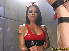 BDSM transgender nurse suspends sub and jerks