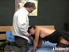 Shemale in stockings gives head