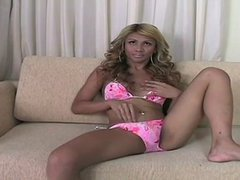 Blond haired ladyboy showing off her body