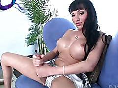 Hot shemale Mia Isabella strokes her cock