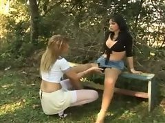 Girl sits on shemale cock outdoors