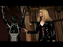 Transsexual Mistress and Her rubber gimp