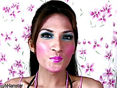 Pretty face ladyboy plays with small titties and shaved cock  - clip # 02