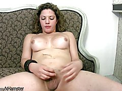 Striking shemale with curly hair strokes her thick shemeat  - clip # 02