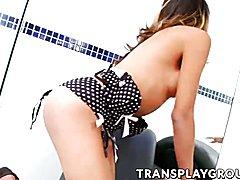 Cute transexual Brenda Castro pleasures herself on a sofa