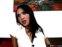 Cute Thai TS school t-girl strokes two dicks single handedly