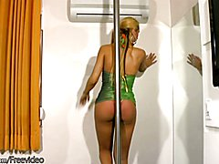 Tall blonde shedoll in green dress does striptease and jerks