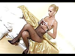 Blonde Tranny In FishNet Solo play on sofa