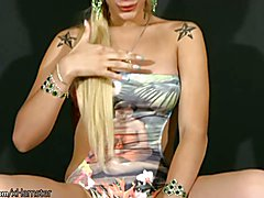 Transsexual with long blonde hair plays with shaft and balls  - clip # 02