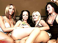 Chicks with dicks enjoy licking their big tits in foursome