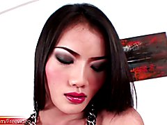 Gorgeous Thai t-girl in dress plays with her shaved cock