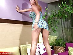 Blonde shemale babe shows her huge ass in thong and shecock