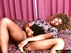 Curly haired ebony shemale slips banana in her ass and jerks  - clip # 02