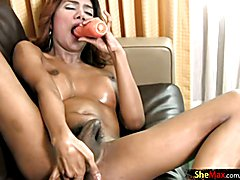 Curvy ladyboy dances in tight jeans and fucks a carrot dildo  - clip # 02