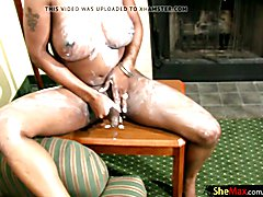 Horny TS gets her black skin covered in lotion and wanks off  - clip # 02