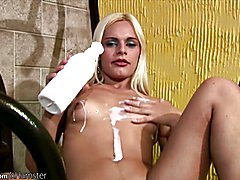 Blonde shedoll with natural tits enjoys milk bath and jerks  - clip # 02
