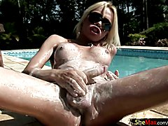 Oiled up blonde shemale squeezes her big balls and ladystick