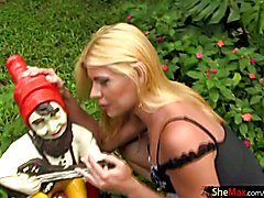Attractive blonde shemale strips outdoors and shows huge ass