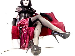 Masked Kinky Crossdresser in red dress and heels playtime