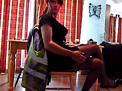 Wearing a sexy short black dress niylon tights high heels