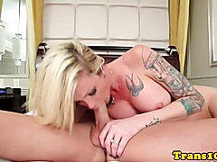Tattooed tranny cockriding after giving head