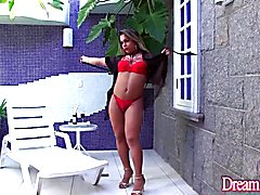 Shemale Thayla Santos masturbates with a large dildo