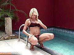 Blonde transvestite w red heels masturbates off massive prick