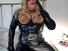 Latex smoking blond tgirl in red lipstick
