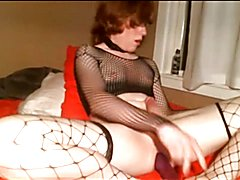 Young she-male fucks a large sextoy and goes up on herself