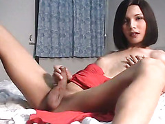Thai ladyboy in sexy red dress masturbating.